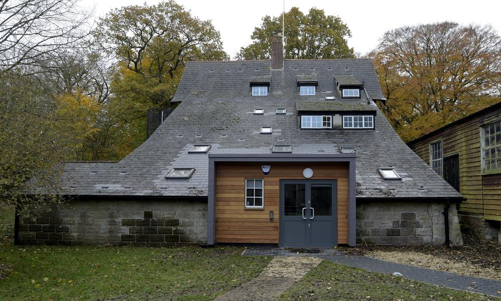 The rear of the Chalet building features a 'cat-slide' roof